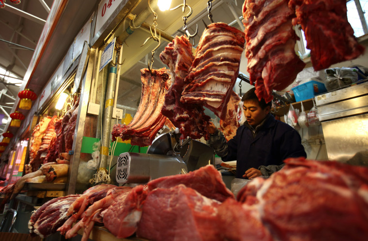 Image: A butcher stands at his stall