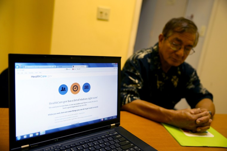 Image: Americans Sign Up For Health Insurance On ACA Deadline Day