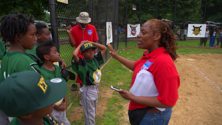 Officer Angela  Wormley is a volunteer coach for the Englewood Police Youth Baseball League.