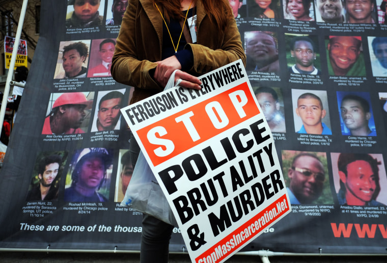 Image: A protester displays a placard at the Union Square in New York