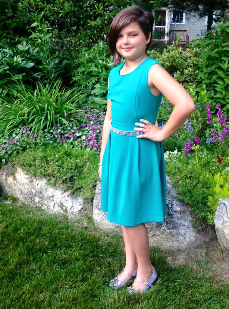 """Lia, 10, all dressed up for her fourth grade recognition ceremony where she gave an """"end of the year"""" speech to her classmates and their parents."""