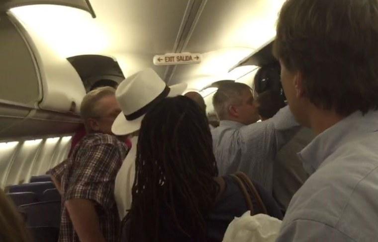 Passengers evacuate Southwest flight 397 in Houston on June 26.