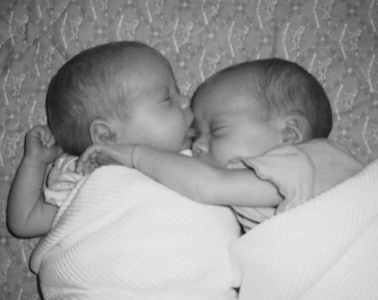 "Mom Traci Whittington Craft writes on Facebook, ""My sweet fraternal twins are now 9 years old and even now when they sleep together, I will find them asleep as they are in this picture from when we brought them home from the hospital. I'm beyond blessed to have been selected to be a mommy of twins. They bless me each and every day."""