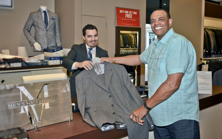 Lionel Hollins, head coach for the Brooklyn Nets, takes part in the suit drive.
