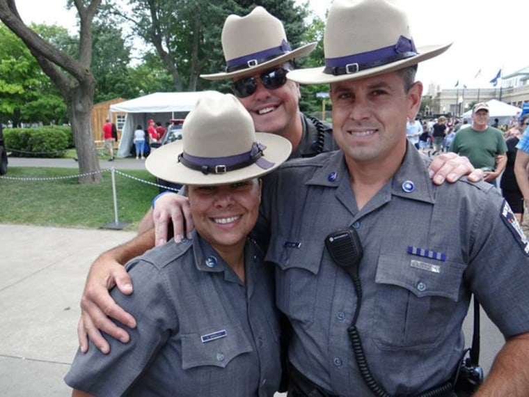 Image: Xaymara Morales, Jon Giddings and Sgt. Jay Cook