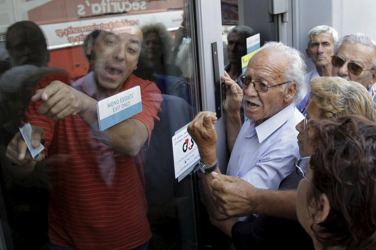 Image: Pensioners waiting outside a closed National Bank branch
