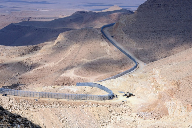 Image: A panoramic view of some of the border fence Israel has completed separating Israel from Egypt
