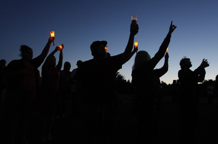 Image: Supporters attend a candlelight vigil after a shooting at Reynolds High School in Troutdale, Oregon