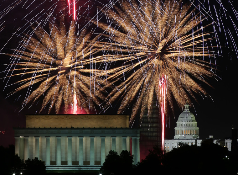 Image: Fireworks light up the sky over the Lincoln Memorial, Washington Monument, and the U.S. Capitol on July 4, 2013