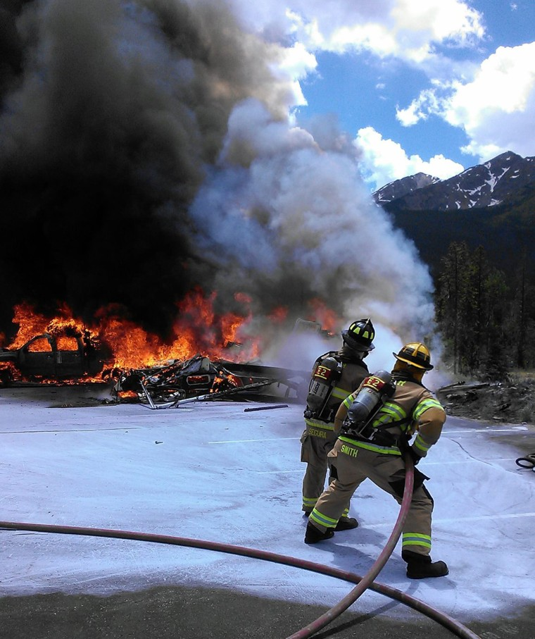 Lake Dillon Fire officials battle a fire after a medical helicopter crashed outside of a hospital in Frisco, Colorado, Friday. The pilot was killed and a paramedic and nurse were injured, officials said.