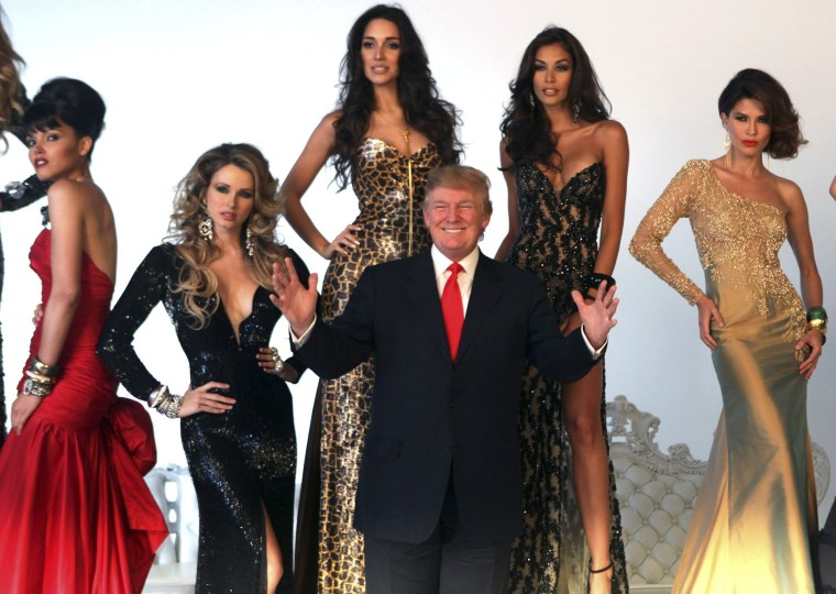 Image: File photo of Donald Trump posing with Miss Universe winners during a pageant photo shoot in New York