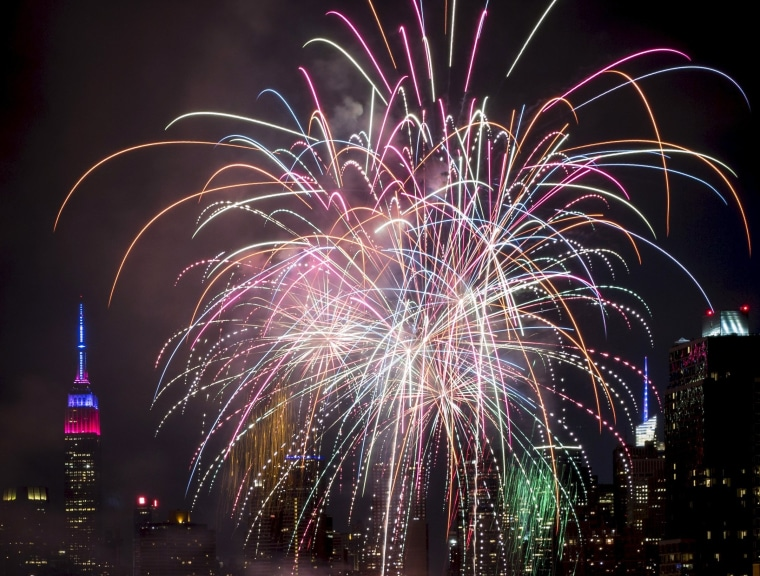 Image: The Macy's 4th of July Fireworks explode for Independence Day on the East River in New York