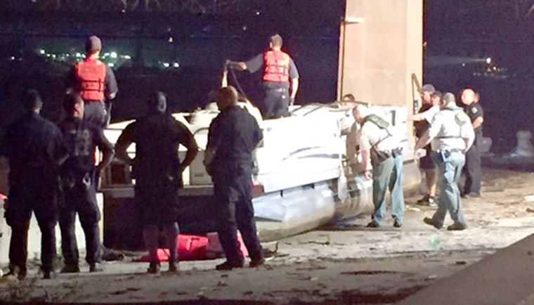 Image: Police say at least two people are dead after a boat capsized on the Ohio River near Louisville, Ky. on Saturday.