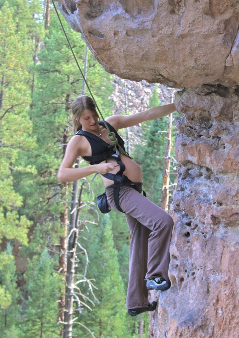 Rachael Farmer, pregnant with daughter Ellie, traverses a rock face