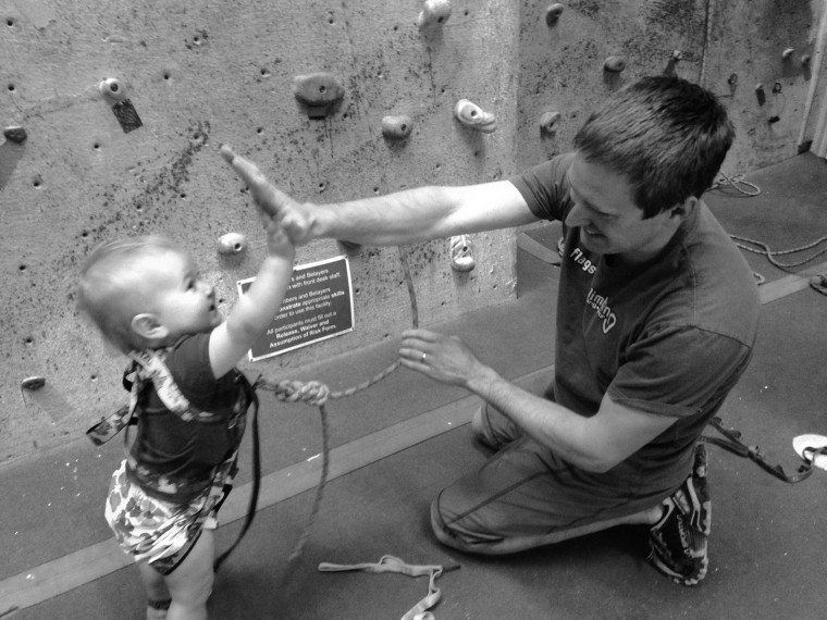 Zak Farmer high fives his 20-month-old rock climbing daughter, Ellie