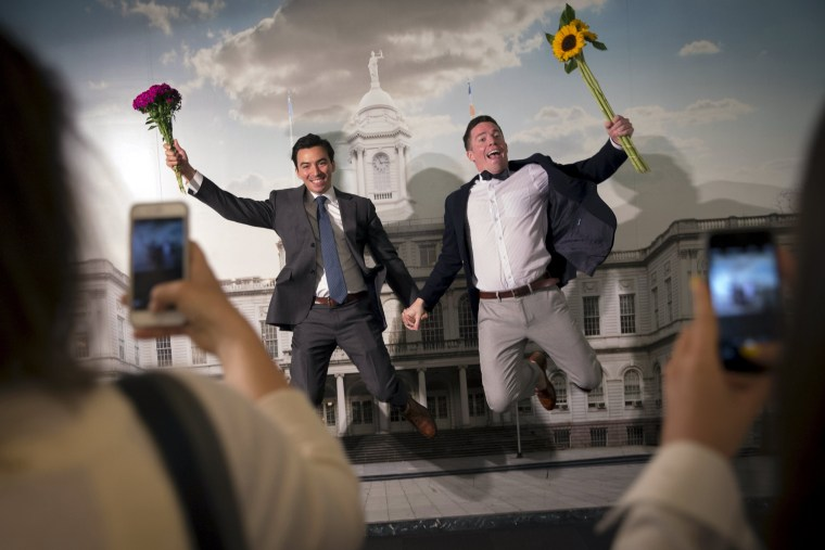 Rodrigo Zamora and Ashby Hardesty pose together for friends at the New York City clerks office after their wedding in Manhattan in New York June 26, 2015.