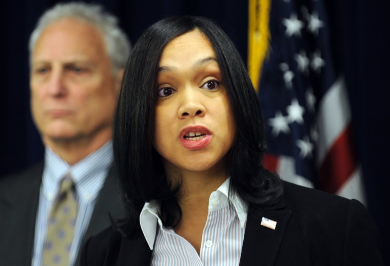 In this Feb. 3, 2015 photo, Marilyn Mosby, right, Baltimore City State's Attorney, holds a press conference regarding the Phylicia Barnes case.
