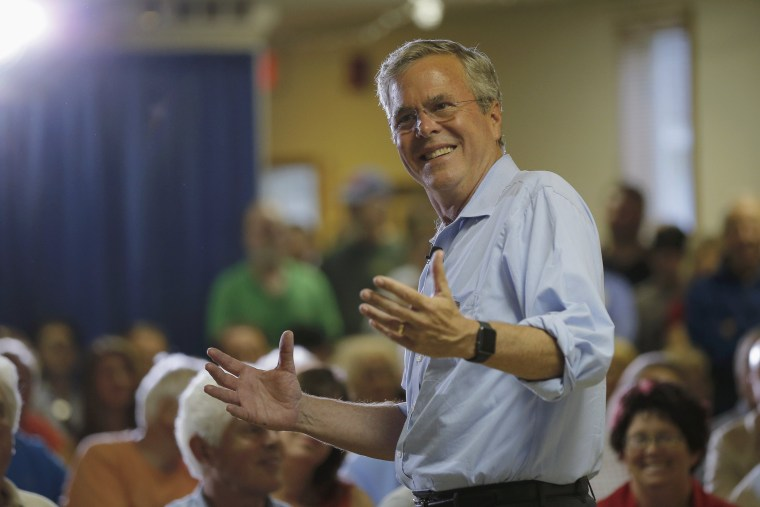 Image: Bush answers a question from the audience during a town hall campaign stop at the VFW Post in Hudson