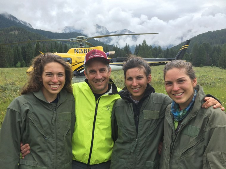 Image: Sisters Kelsi, 16, Megan, 25, and Erin Andrews-Sharer, 22, with their father after their rescue in Grand Teton National Park.