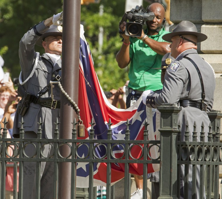 Image: Honor guard removes the Confederate battle flag permanently from the South Carolina statehouse grounds during a ceremony in Columbia, South Carolina