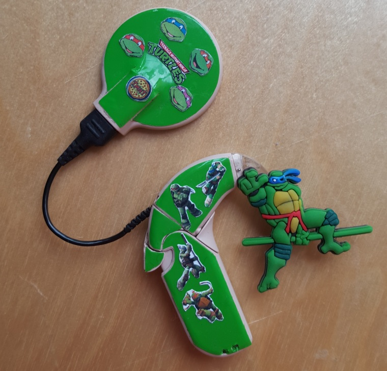 This cochlear implant by Lugs features images of the Teenage Mutant Ninja Turtles.