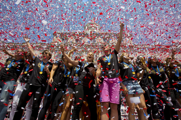 Image: The U.S. women's soccer team cheer during a reception at New York City Hall to celebrate their World Cup final win over Japan, in New York