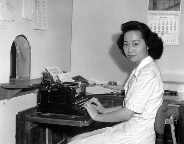 Mitsuye Endo, Supreme Court figure, seated at her desk in the administrative office at the Central Utah Relocation Center, 1942.