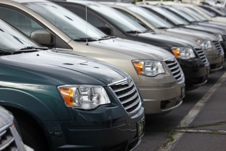 Town & Country minivans sit at a Chrysler-Jeep dealership in the south Denver suburb of Englewood, Colorado, in 2009.