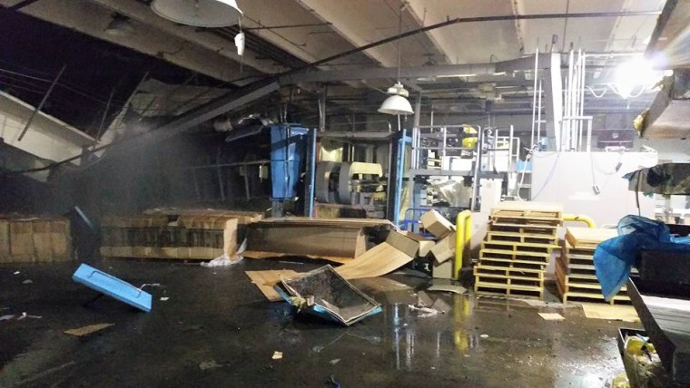 The aftermath of an explosion at the Zodiac Aerospace plant in Newport, Washington, on Tuesday.