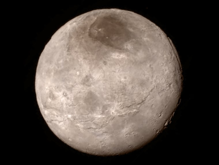 Remarkable new details of Pluto's largest moon, Charon, are revealed in this image from New Horizons' Long Range Reconnaissance Imager, taken late on July 13 from a distance of 289,000 miles (466,000 kilometers).