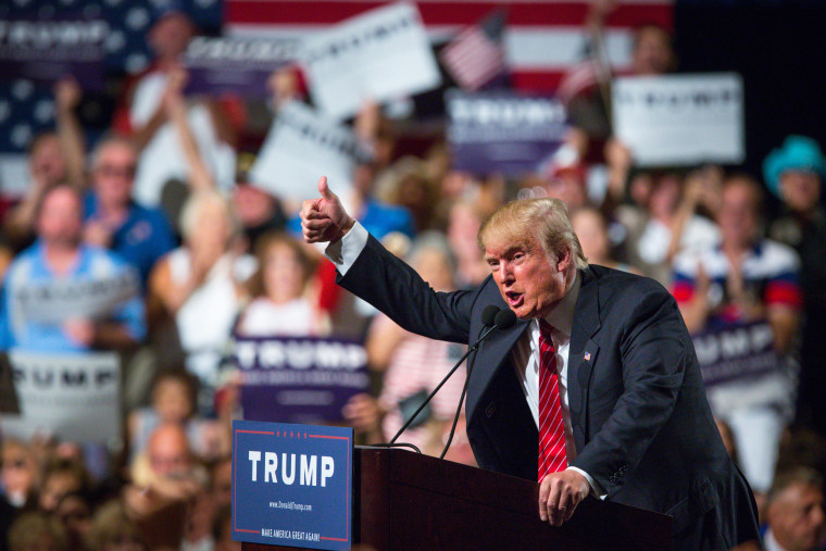 Republican Presidential candidate Donald Trump addresses supporters during a political rally at the Phoenix Convention Center on July 11, 2015.