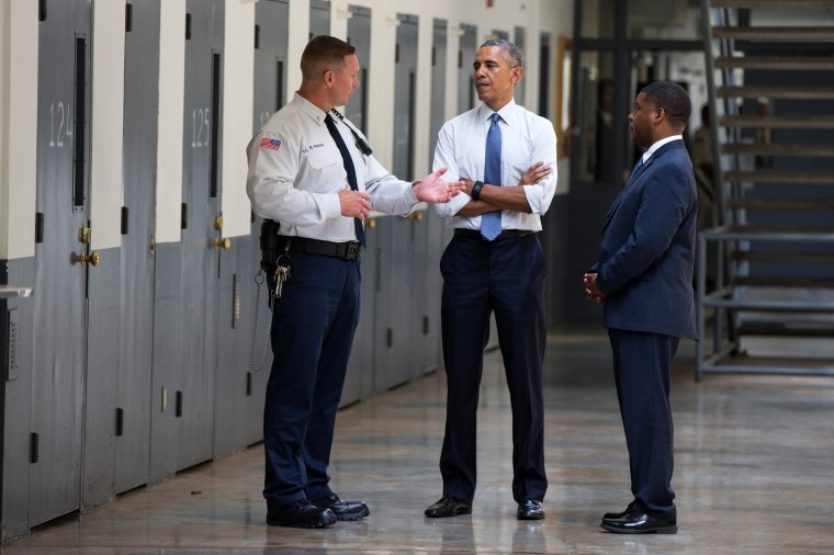 Image: President Barack Obama is led on a tour of the El Reno Federal Correctional Institution in El Reno, Okla.