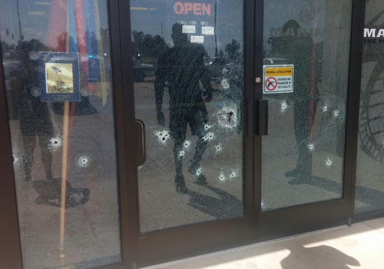 The Armed Forces Career Center through a bullet-riddled door after a gunman opened fire on the building Thursday, July 16, 2015, in Chattanooga, Tenn.