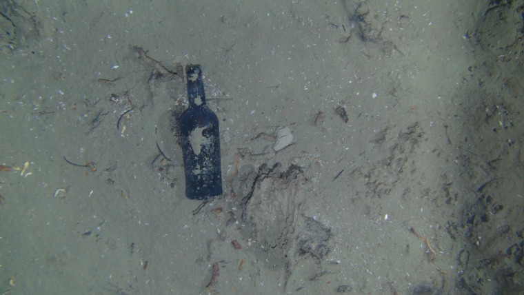 One of nine glass bottles observed at the site of a centuries-old shipwreck off the North Carolina coast.