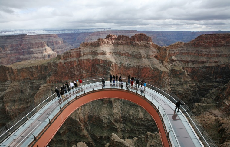 Image: A skywalk extends out over the Grand Canyon in this view from the incomplete building that houses the skywalk, on the Hualapai Indian Reservation
