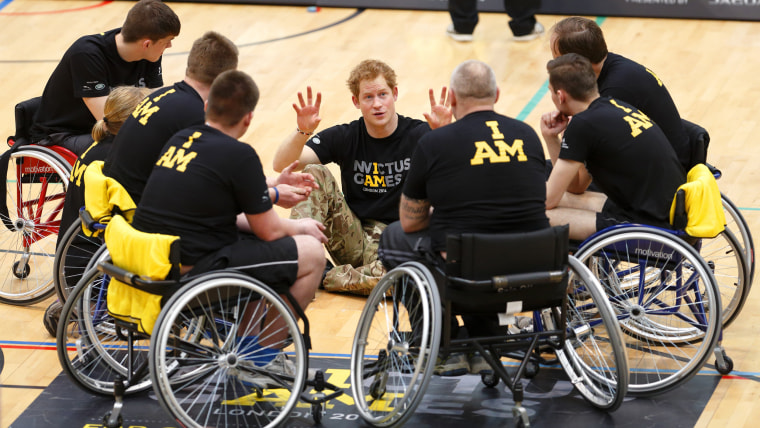 Prince Harry speaks with members of a wheelchair sporting team