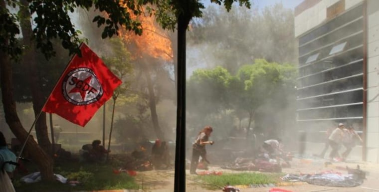 Image: The scene after an explosion in the town of Suruc