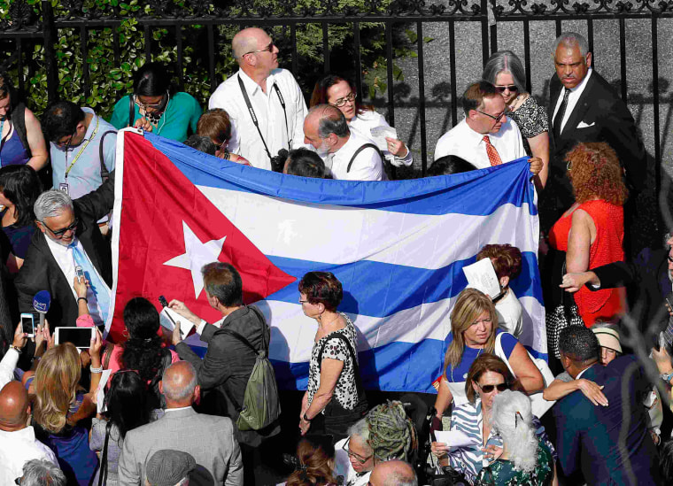 Image: Cuban flag is carried by people before embassy reopening in Washington