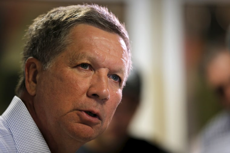 Image: Potential Republican presidential candidate and Ohio Governor John Kasich answers questions from reporters following a tour of the Red Hook Brewery in Portsmouth