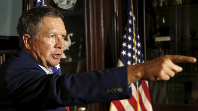 Image: Republican Ohio Governor John Kasich gestures at a news conference