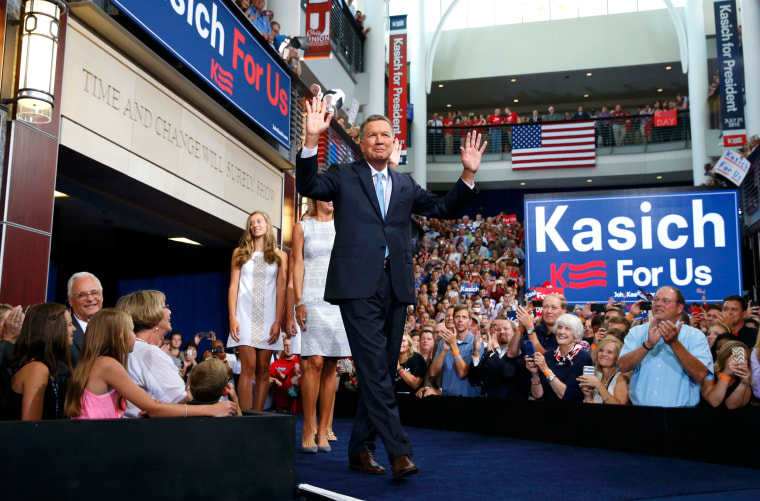 Image: Republican U.S. presidential candidate and Ohio Governor John Kasich arrives on stage to formally announce his campaign for the 2016 Republican presidential nomination during a kickoff rally in Columbus