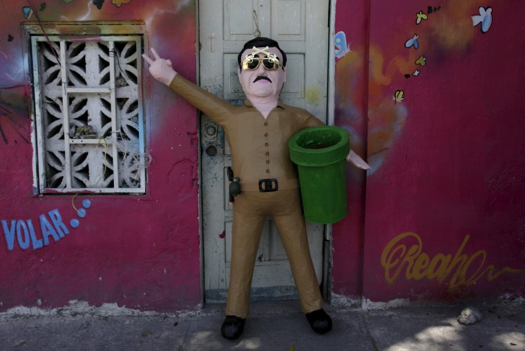"""Image: A pinata depicting """"El Chapo"""""""