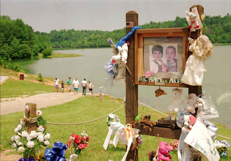 In a July 9, 1995 file photo, visitors walk down the ramp where Alex and Michael Smith were drowned in a car in 1994 in Union, S.C., by their mother, Susan Smith.
