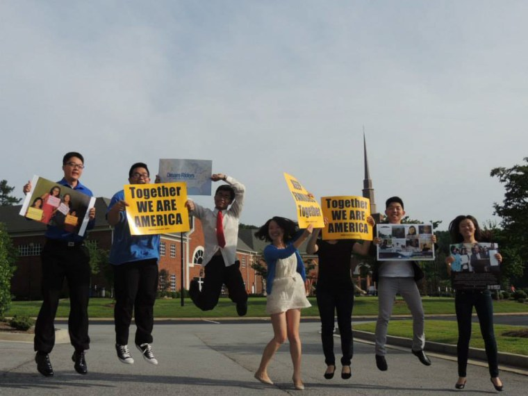 Image: Dream Riders holding signs.