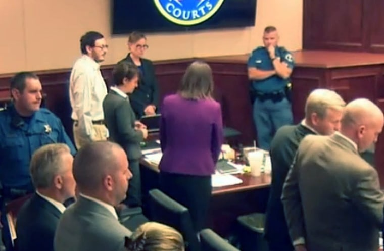Colorado theater shooter James Holmes, top left in light shirt, stands for the entrance of the jury during his murder trial.