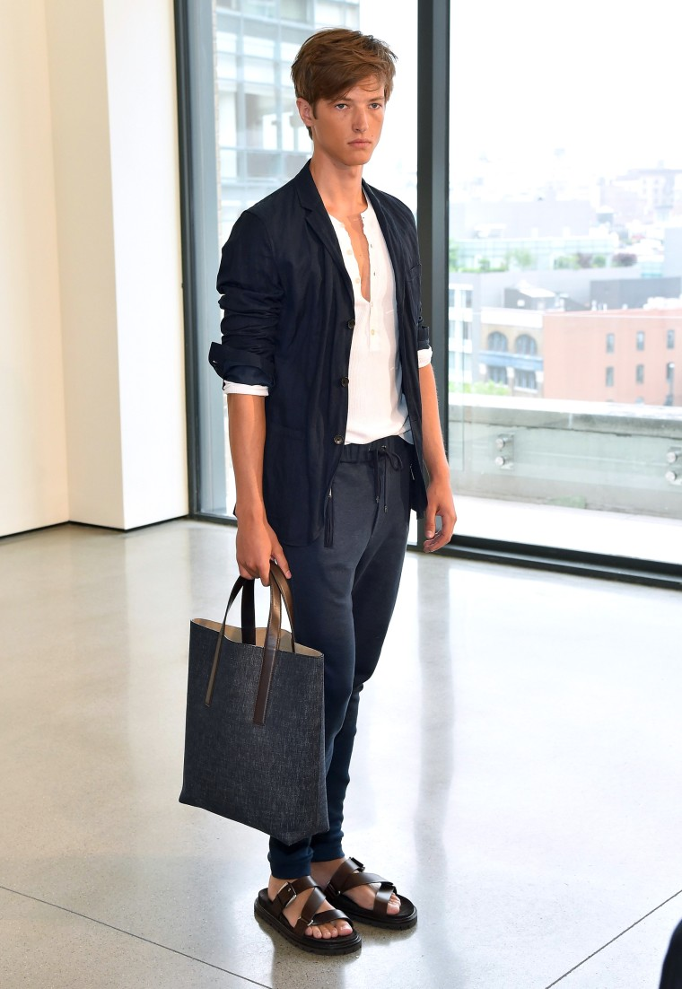 Navy business casual sweater, pants - A model walks at the Michael Kors Spring 2016 Presentation during New York Fashion Week: Men's