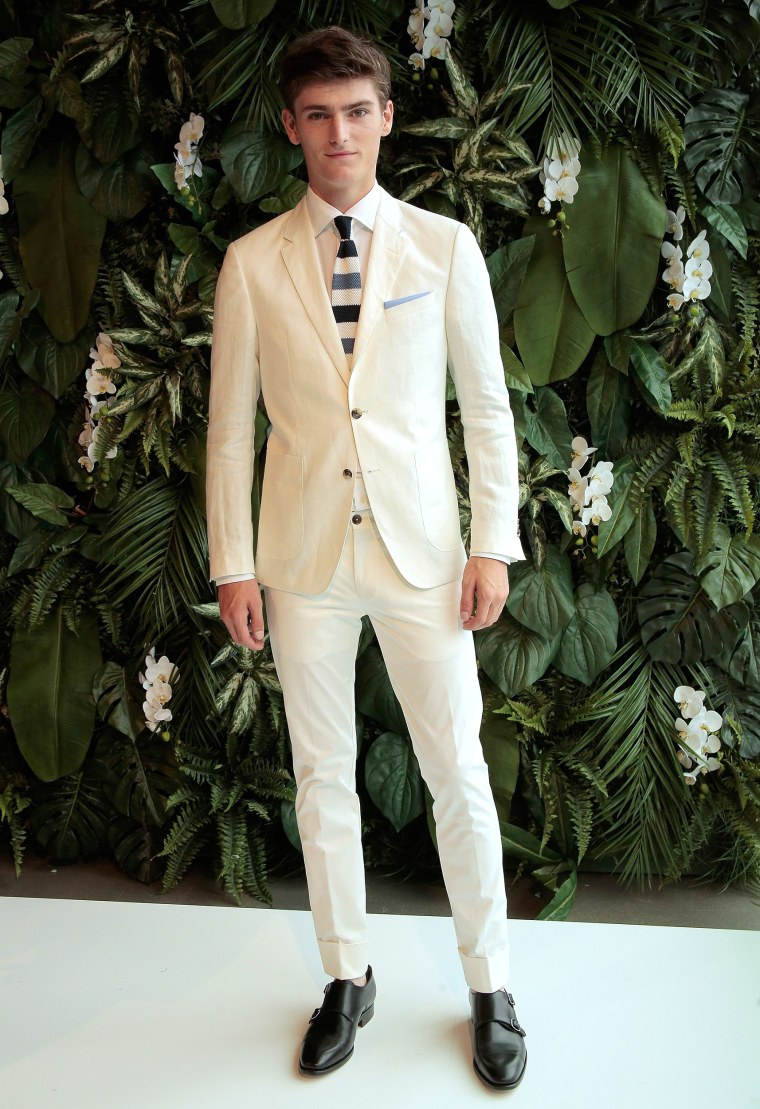 White Linen Suit - A model poses on the runway at the Tommy Hilfiger Spring 2016 Men's Tailored Collection presentation