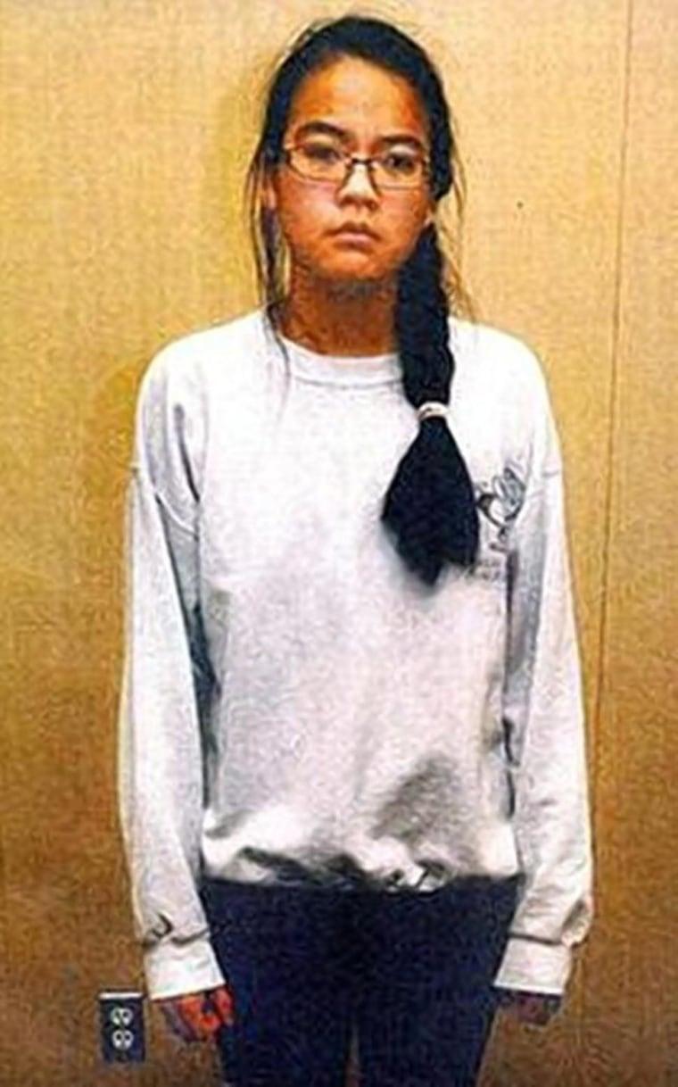Jennifer Pan is seen after being taken into police custody.