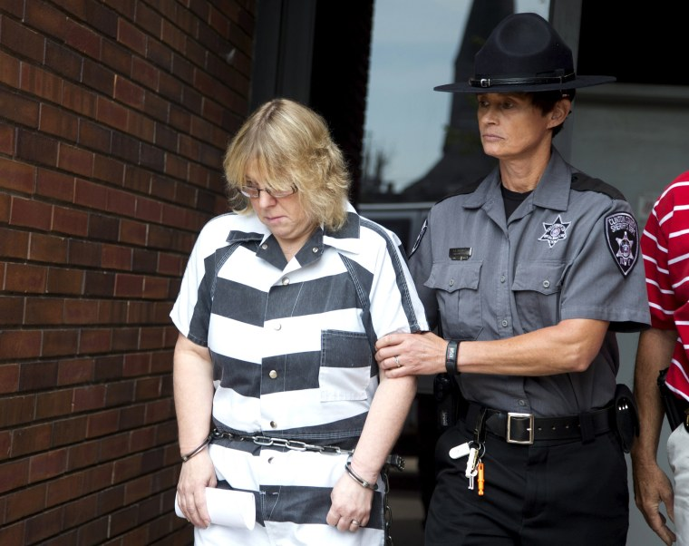 Image: Joyce Mitchell is escorted out of the court house after pleading guilty at Clinton County Court, in Plattsburgh, New York
