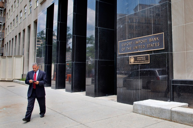 Image: A man walks out of the Export-Import Bank
